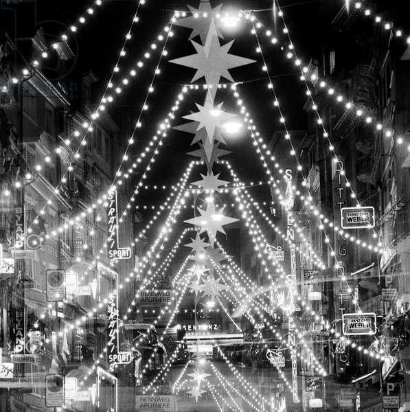 Christmas lighting pictured on Rennweg in Zurich, Switzerland, on November 29, 1958 (b/w photo)