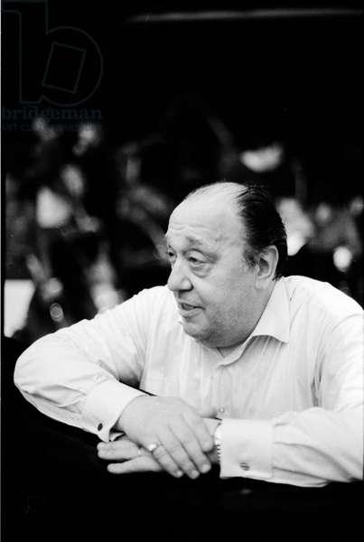 Nello Santi in the orchestra pit conducting at  Paris Opera, 1991 (b/w photo)