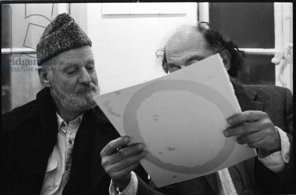 Lawrence Ferlinghetti and Allen Ginsberg at library Village Voice, Paris, France, 1982 (b/w photo)