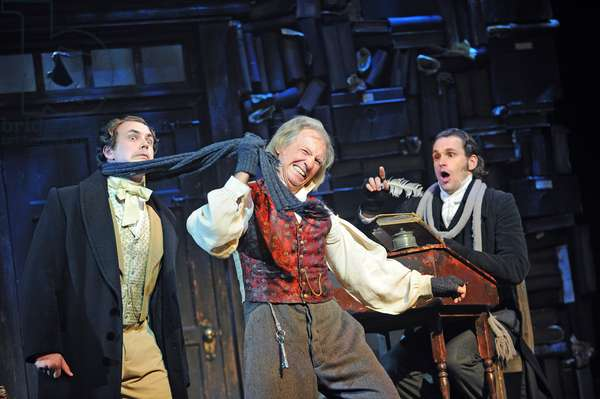 Craig Whitely (Harry), Tommy Steele (Ebenezer Scrooge) and Edward Handoll (Bob Cratchit) in Scrooge The Musical at London Palladium (Opening 6-11-12) (photo)