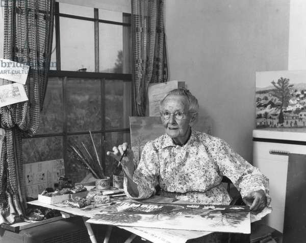 Grandma Moses Painting in the Room Behind her Kitchen, 1952 (b/w photo)