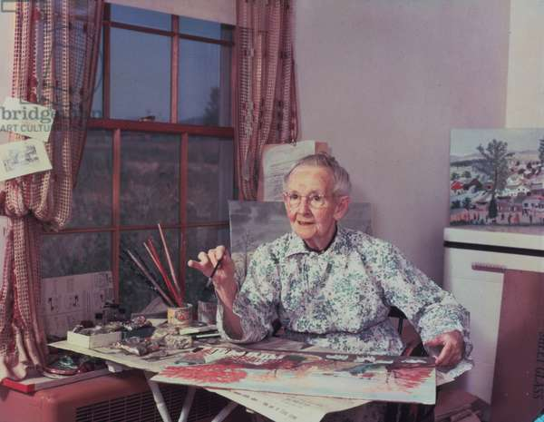 Grandma Moses Painting in the Room Behind her Kitchen, 1952 (photo)