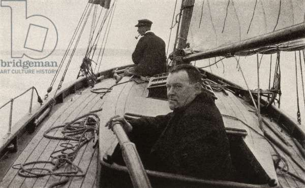 Hilaire Belloc in his boat (b/w photo)