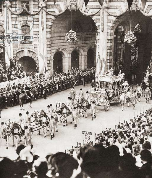 The coronation coach of King George VI and Queen Elizabeth passing through Admiralty Arch, London, England on the day of their coronation in 1936