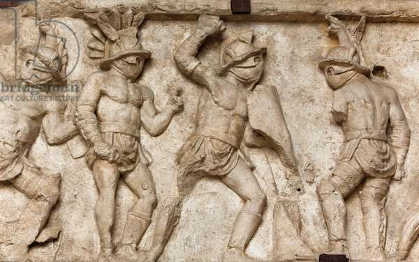 Bas relief of gladiators fighting, Colosseum, Rome, Italy (photo)