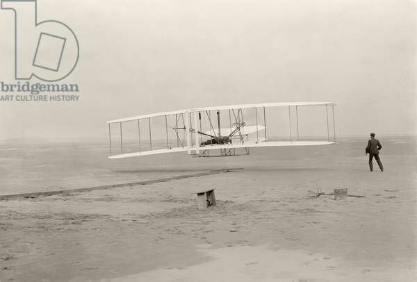 The Wright Flyer I makes its first flight of 120 feet in 12 seconds, at Kitty Hawk, North Carolina, 10.35am, 17 December 1903 (b/w photo)