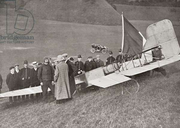 The landing of Blériot at Dover, England in1909 after making the first flight across the English Channel in a heavier than air aircraft.  Louis Charles Joseph Blériot,  1872 – 1936.   French aviator, inventor and engineer.  From The Wonderful Year 1909
