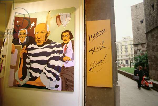 Cartoon of Picasso, Dali and Miro in a shop entrance (photo) (see 141254)
