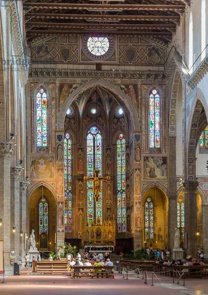 Florence, Tuscany, Italy.  Santa Croce Basilica.  View along length of nave to altar. (photo)