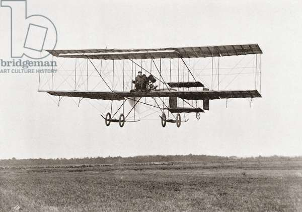 Henri Farman winning the Grand Prix of two thousand pounds for the longest flight of 112 miles in a  Farman III Biplane at The Grande Semaine d'Aviation de la Champagne, Reims, France  in 1909.  Henri Farman, 1874 – 1958.  French pilot, aviator and aircraft designer and manufacturer.  From The Wonderful Year 1909