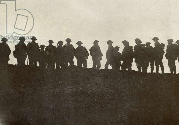 Silhouette of reserve soldiers waiting to move up to the front line during World War One, from The Year 1916 Illustrated