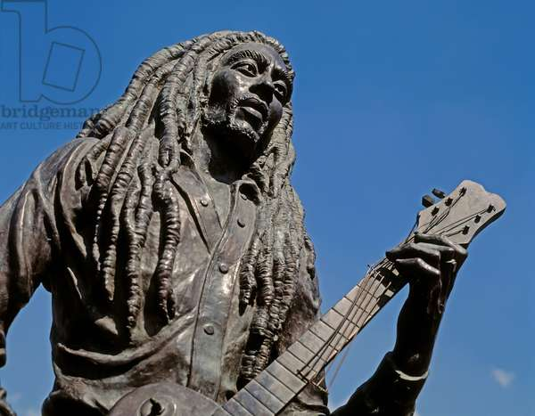 Kingston, Jamaica.  Bronze statue of singer songwriter Bob Marley, 1945 - 1981, in Celebrity Park.  The statue was created by Jamaican sculptor Alvin Marriot, 1902 - 1992.