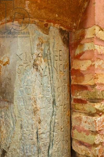 Carmona, Seville Province, Spain. Prioral de Santa Maria.  Priory of Santa Maria. 6th century Visigothic calendar carved into pillar in Orange Tree patio.