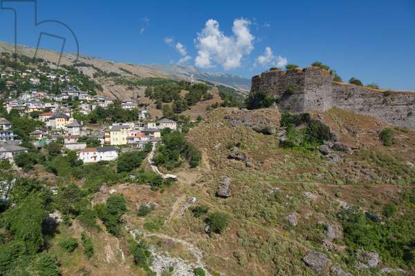Gjirokastra or Gjirokaster, Albania. The Castle or Citadel with a suburb of the town to the left.  Gjirokastra is a UNESCO World Heritage Site. (photo)