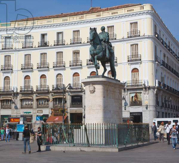 Madrid, Spain.  Puerta del Sol.  Equestrian statue of King Carlos III. (photo)