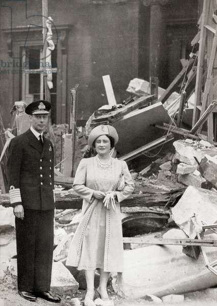 King George VI and Queen Elizabeth outside Buckingham Palace which suffered bomb damage on 13 September 1940, during WWII (photo)