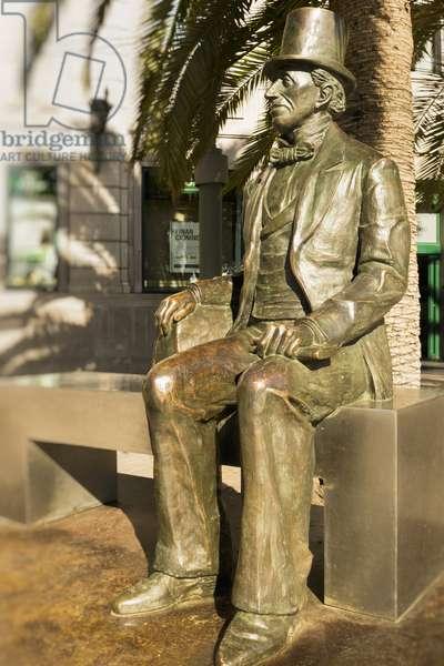 Statue celebrating the 1865 visit to Malaga of Danish author Hans Christian Andersen (1805-1875) in the Plaza de la Marina, Malaga, Costa del Sol, Malaga Province, Andalusia, Southern Spain (photo)