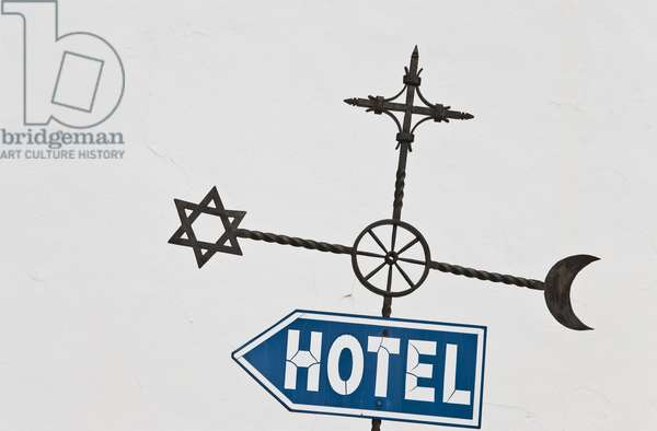 Street sign with Jewish, Christian and Islamic symbols (photo)