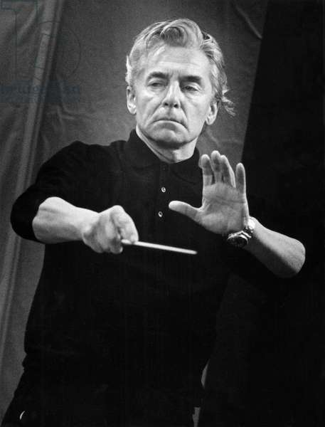 Herbert von Karajan conducting with baton. Austrian conductor, 5 April 1908 - 16 July 1989.