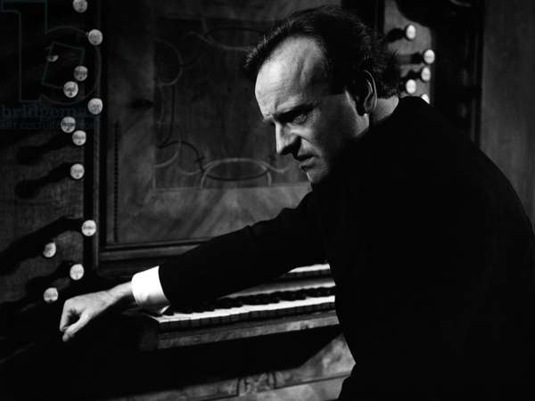 Karl Richter sitting at the organ. German organist and conductor, 15 October 1926 - 15 February 1981.