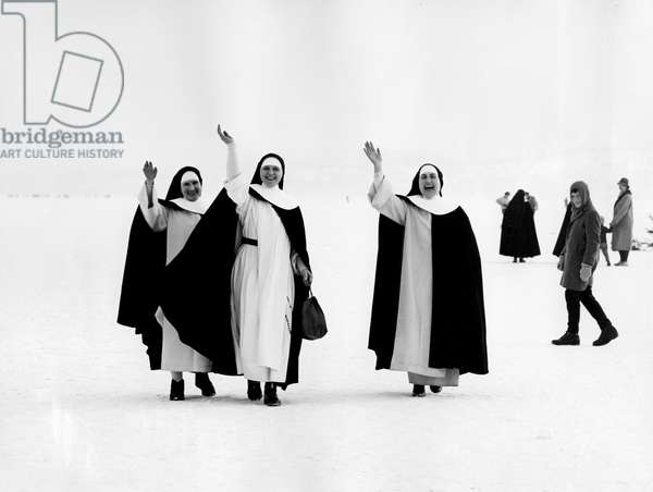 Nuns waving on the ice at Lake Constance in 1963
