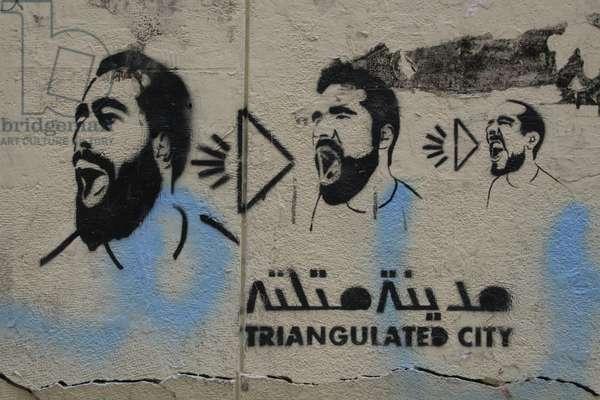 Graffiti depicting men shouting, 2010 (photo)