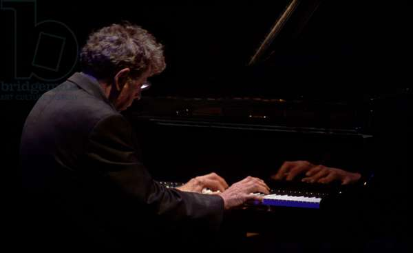 Philip Glass performing on piano