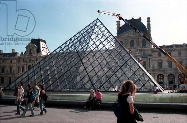 Louvre Pyramid Window Cleaners a Crane Supports Window Cleaners Working on the Glass Diamonds of the Louvre Pyramid, Paris (photo)