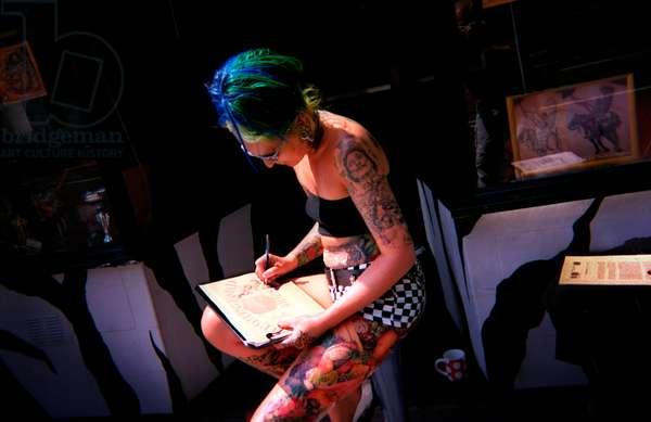 Tattooist designing