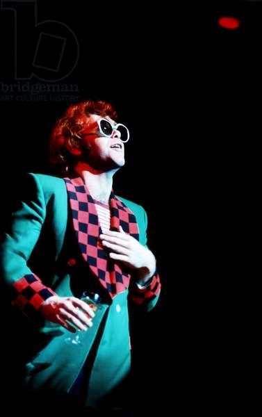 Elton John performing 1970s