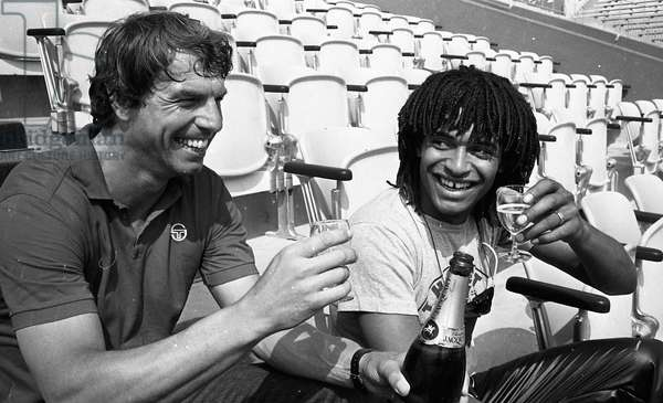 Yannick Noah winning the French Open tennis tournament Roland-Garros with his coach Patrice Hagelauer, Paris, France, may 1983