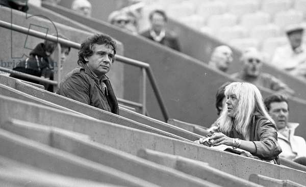 Michel Sardou and wife Babette during the French Open tennis tournament, Paris, France, 1983 )
