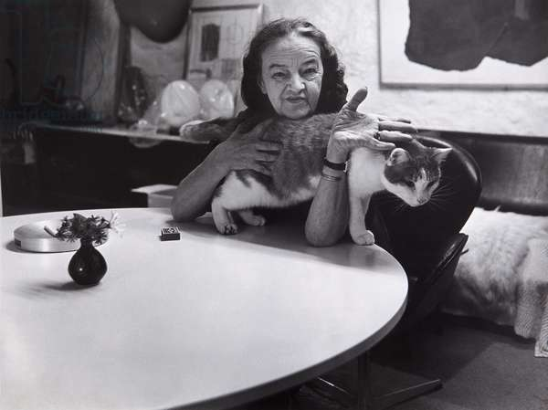 Barbara Hepworth seated at her dining table, Trewyn Studio, St Ives, 1971 (b/w photo)