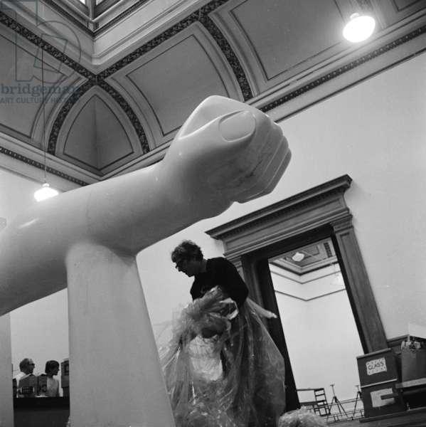 Kenneth Armitage preparing an exhibition (b/w photo)