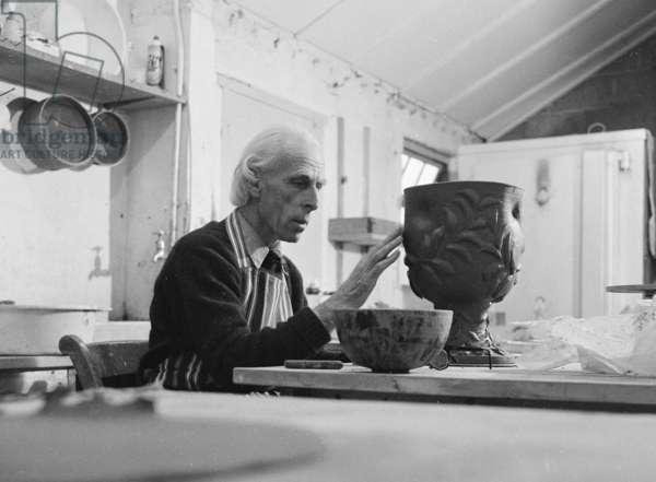 John Piper decorating a pot, 1972 (b/w photo)