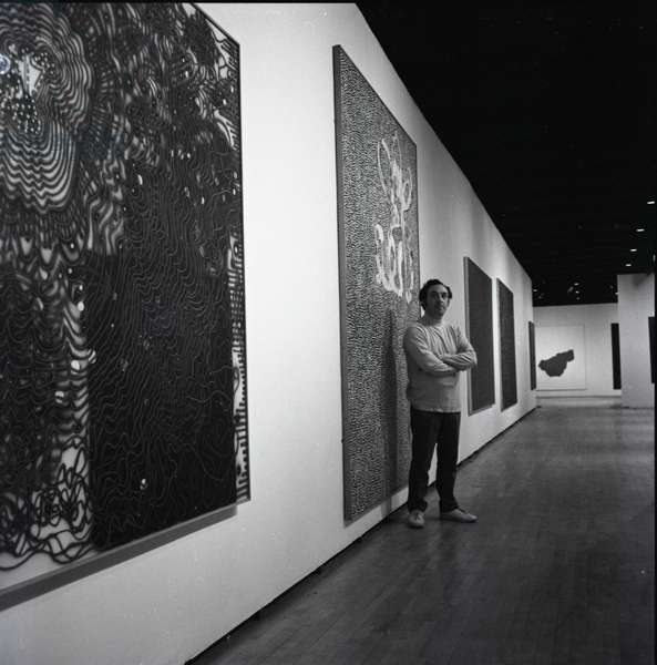 Portrait of Bernard Cohen at his exhibition at the Hayward Gallery, London, 1972 (b/w photo)