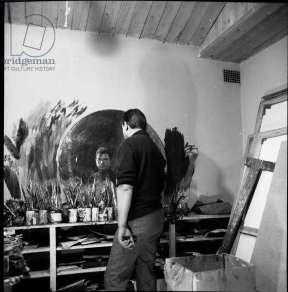 Francis Bacon in his studio, 1963 (b/w photo)