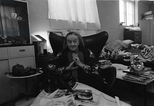 Barbara Hepworth in the studio seated in a Jacobson egg chair, April 1973 (b/w photo)