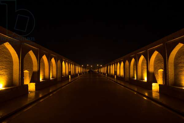 A View Of The Si-O-Seh Bridge At Night Highlighting The 33 Arches, Isfahan Province, Isfahan, Iran, 2016 (photo)