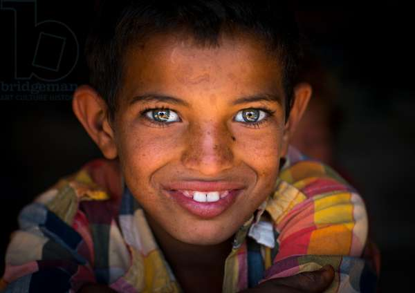 Smiling Gypsy Boy With Beautiful Eyes, Central County, Kerman, Iran, 2016 (photo)