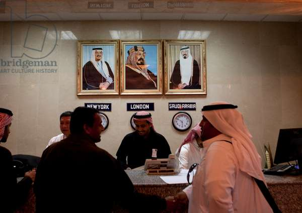 Hotel Reception with the Rulers Portraits, Saudi Arabia (photo)