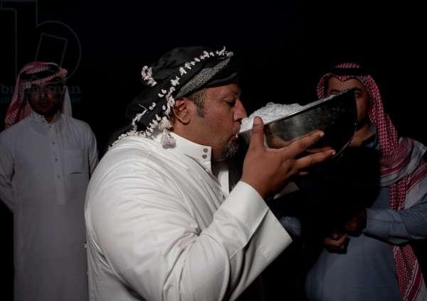 Beduin Drinking Camel Milk in Sakakah Desert, Saudi Arabia (photo)