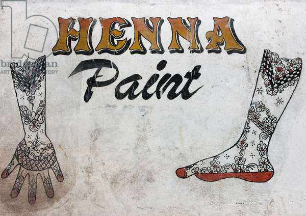 Henna paint sign painted on a wall, Lamu, Kenya, Africa (photo)