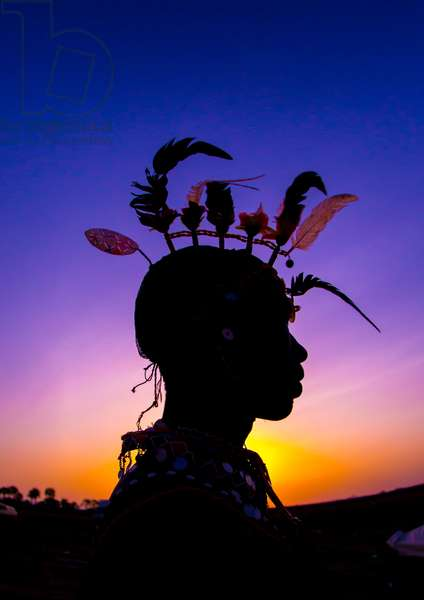 Silhouette of rendille warrior wearing traditional headwear, Turkana lake, Loiyangalani, Kenya, Africa (photo)