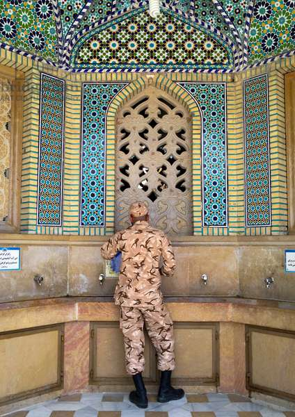 Soldier Taking Water At A Fountain At The Shah-E-Cheragh Mausoleum, Fars Province, Shiraz, Iran, 2015 (photo)