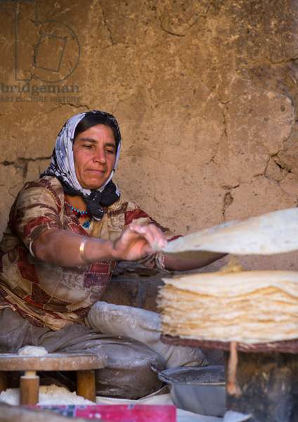 Kurdish Woman Making Local Bread, Palangan, Iran, 2013 (photo)