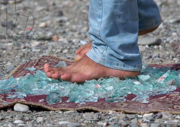 Man Walking On Broken Glass, Hormozgan, Minab, Iran, 2015 (photo)