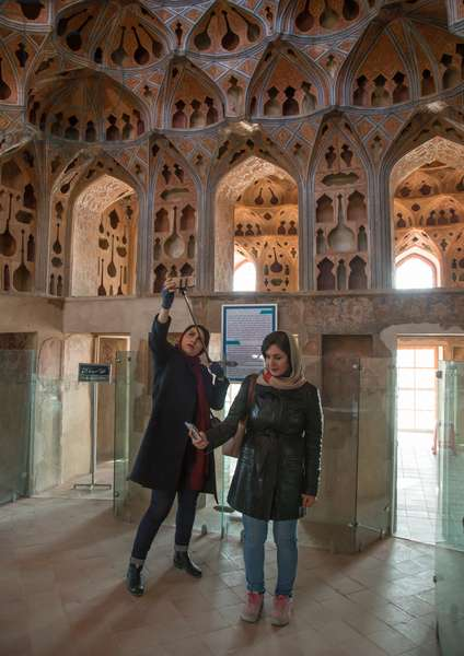 Iranian Women Taking Selfie Picture In The Acoustic Ceiling In The Music Room Of Ali Qapu Palace, Isfahan Province, Isfahan, Iran, 2016 (photo)