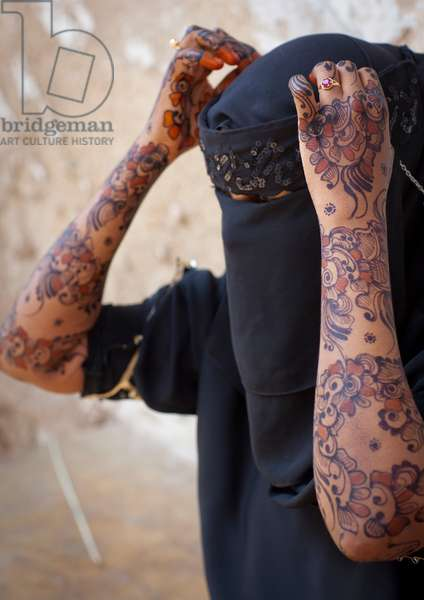Henna painted arms young woman wearing hijab in lamu, Kenya, Africa (photo)