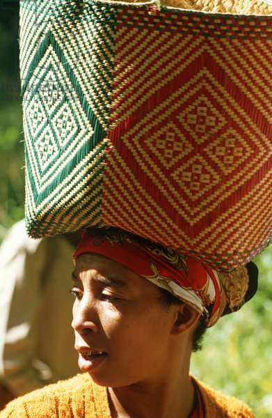 Woman with basket on head making way through Perinet reserve famous for its Lemurs, Madagascar, East Africa, Africa, 1980s (photo)